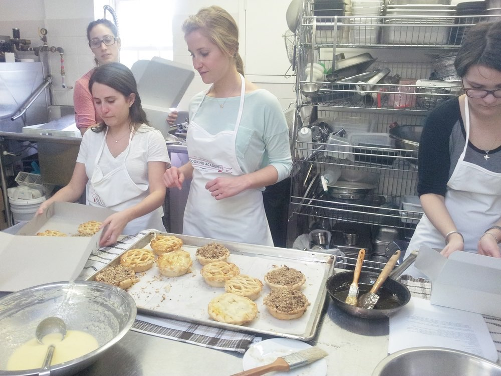 Trainee chefs backing at the Collingwood Cooking Academy