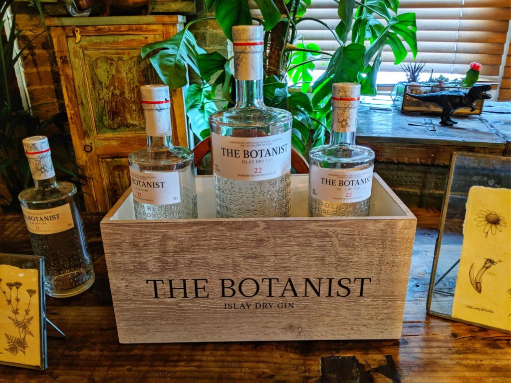 Botanist Gin shown on table in cocktail bar