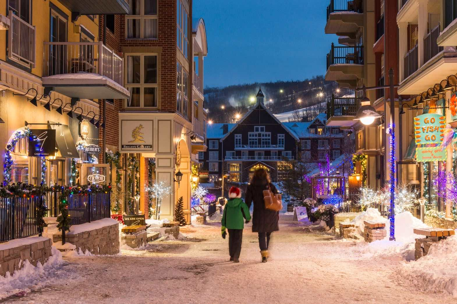 Things to do in Blue Mountain Village include walking its lanes in winter with your kids