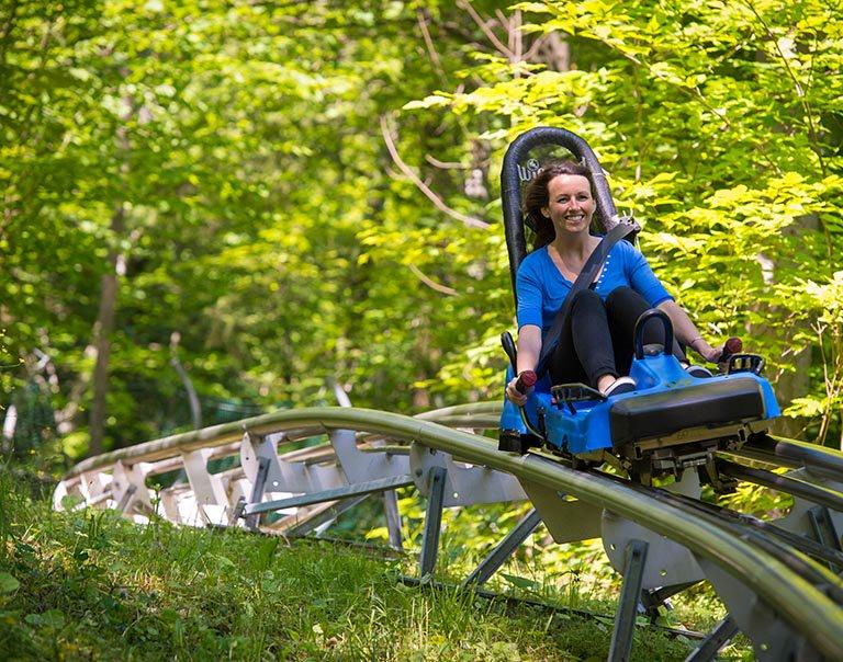 Woman enjoying fun things to do in Blue Mountain Village on the Ridge Rider