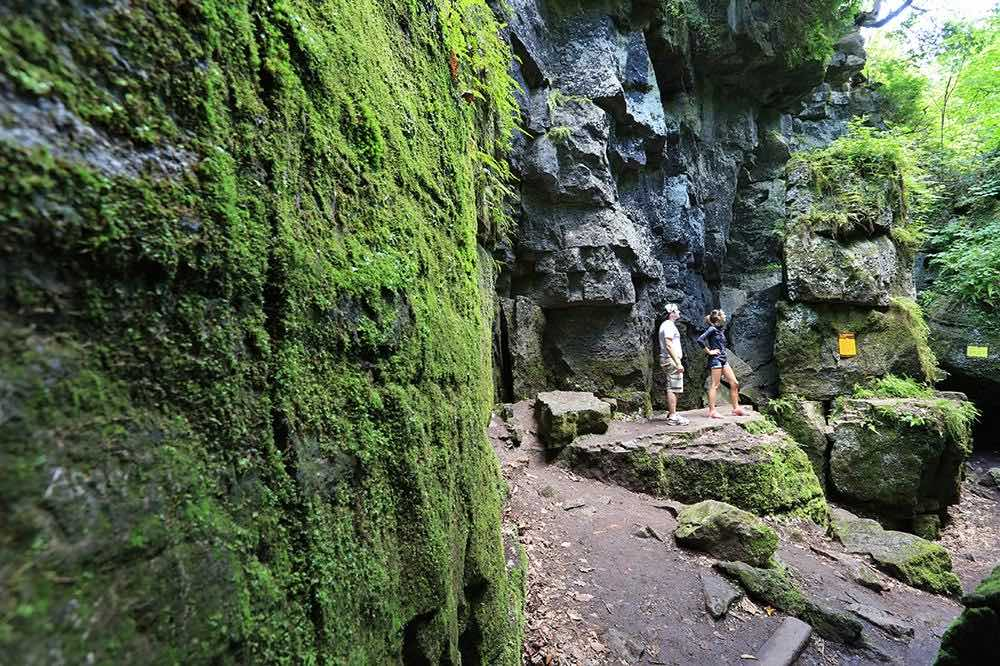 Couple shown exploring the Blue Mountains Scenic Caves in summer