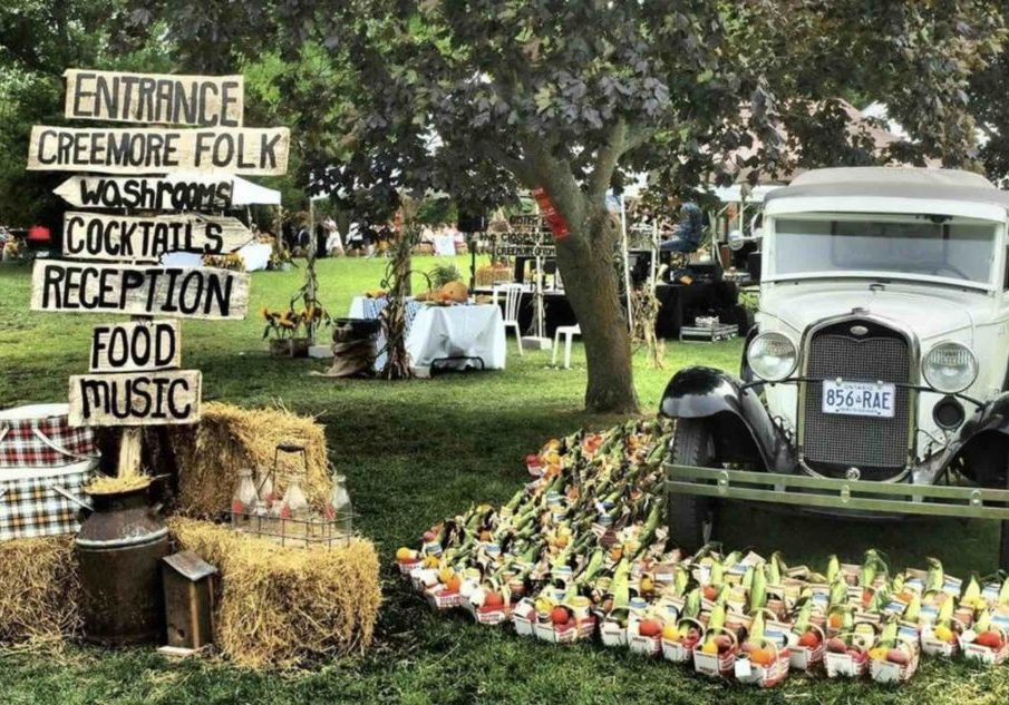 The Copper Kettle Festival in Creemore with old truck and sign