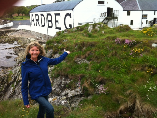 The Dam Pub's owners Stephanie Price standing outside a whisky distillery in Scotland