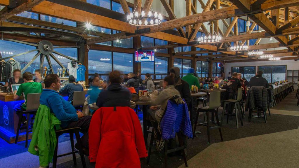 Dining with friends at the Bullwheel Pub is one of the best things to do in Blue Mountain Village in winter