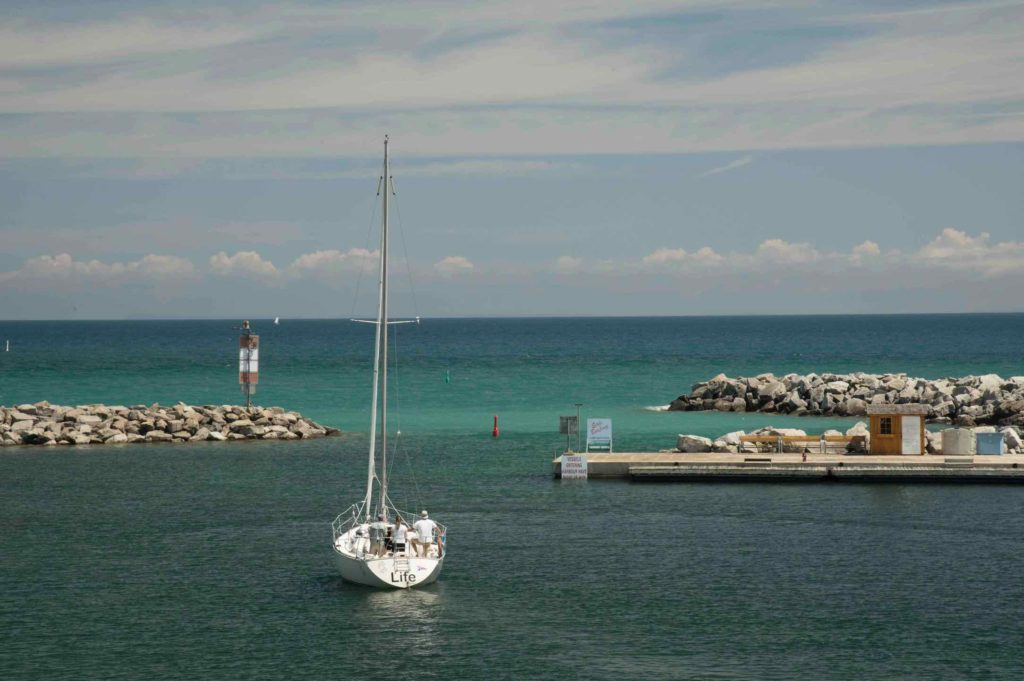 Sailing is one of the top things to do in Thornbury, as this picture shows a boat heading out to Georgian Bay