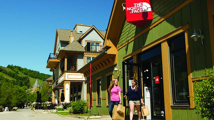 Shopping at North Face like these two women is one of the top things to do in Blue Mountain Village