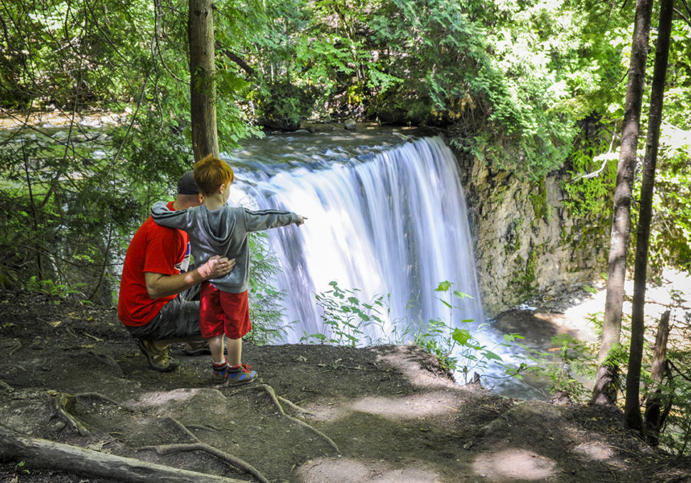 The waterfalls at Grey Highlands with man and child